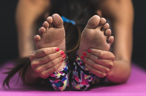 Reaching for toes in a seated stretch position