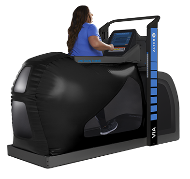 Woman walking in large black treadmill
