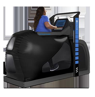Woman walking in large black treadmill